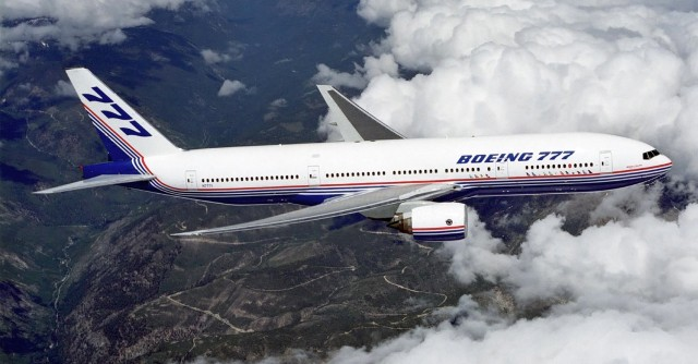 Boeing_777_above_clouds-640x334